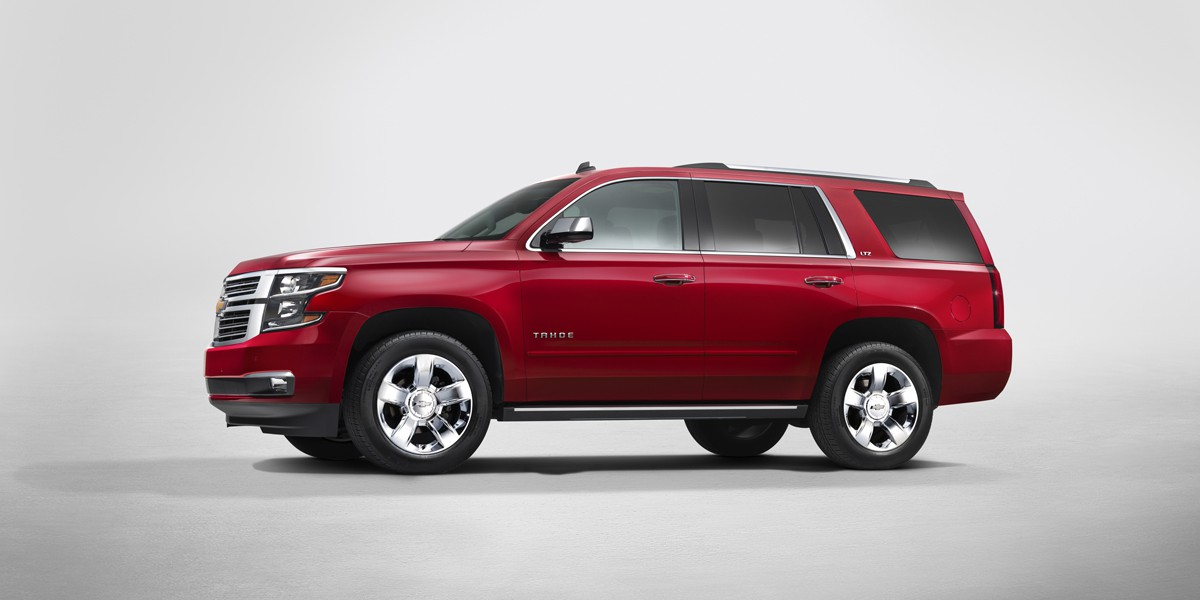 2015 Chevrolet Tahoe in Crystal Claret side view from New York R